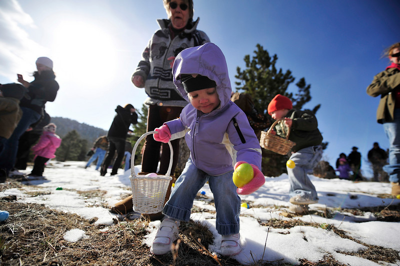 Walt Hester | Trail Gazette<br /> Keira Black, 2, claims a colorful prize at the annual Easter Egg hunt at the Presbyterian Church of the Rockies on Saturday. Children enjoyed photos with the Easter Bunny, colorful eggs, goodies and special prizes, while parents got coffee and donuts.