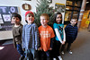 Walt Hester | Trail Gazette<br /> Manuel Arillno, Alexander Henderson, Guunar Friesen, Danna Lujan and Alan Rascon stand by the recently-delivered tree at the elementary school for Arbor Day. Children will plant the tree on the schools grounds on Friday, May 6.