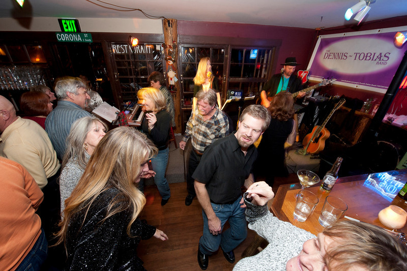 Walt Hester | Trail-Gazette<br /> Revelers enjoy the music of the Dennis-Tobias Band at Mary's Lake Lodge on New Year's Eve. Cold and power outages did not dampen the spirits of partiers in Estes Park.