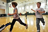 Walt Hester | Trail-Gazette<br /> Estes Park first-graders warm up for PE in the elementary school gym on Wednesday. The students ran several laps around the gym before beginning their class for the day.