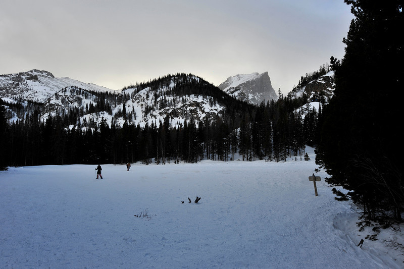 Walt Hester | Trail-Gazette<br /> Snowshoers traverse Nymph Lake. As in summer, the higher or further from the road one gets, the fewer visitors one sees.