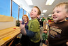 Walt Hester | Trail-Gazette<br /> Calvin Larson, 5, center, shakes a learning toy at the Mountain Top Preschool on Tuesday. Children are encouragd to learn as they play at the preschool.