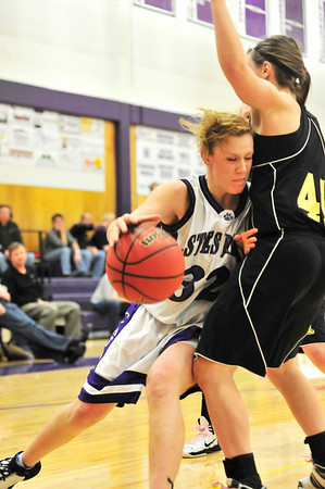 Walt Hester | Trail-Gazette<br /> Senior Kyra Stark runs into a tough Jaguar defense on Wednesday night. Stark scored 11 points before leaving the game with a heal injury.