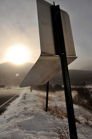 Walt Hester | Trail-Gazette<br /> A broken sign flops around in fierce winds in Horseshoe Park on Wednesday. The winds are dropping already cold temperatures to very uncomfortable levels.