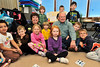 Walt Hester | Trail-Gazette<br /> Peggy and John Lynch sit with children at the Moutain Top Preschool on Tuesday. The couple donated $20,000 to EVICS.