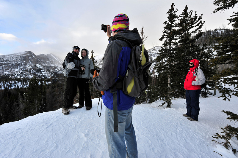 Walt Hester | Trail-Gazette<br /> Fiances Marcel Scioville and Kendra Sand of Washington D.C. pose for Logan Sand and Stephanie Mericka of Fort Collins above Nymph Lake on Sunday. Visitors are coming from far and wide even in the winter cold.