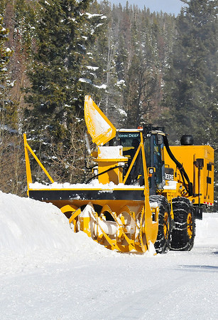 Walt Hester | Trail-Gazette<br /> A rotary plow cuts a path along Bear Lake Road on Wednesday. Enough snow fell in the last several days to require the heavy equipment to clear the national park's roads.