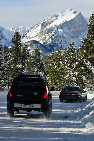 Walt Hester | Trail-Gazette<br /> Cars wheel their ways, slowly, toward Bear Lake and Glacier Gorge over snow-packed roads on Wednesday morning. Enough sunshine broke out in the afternoon to melt snow, creating a messier drive back to town.