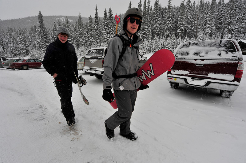 Walt Hester | Trail-Gazett<br /> Matthew, 16, left, and Isaac Fonken head for the slope for a day on their boards on Tuesday. Enough snow has fallen in the park in the last week to make the hike up Hidden Valley worth the effort for boarders and skiers.