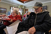 Walt Hester | Trail-Gazette<br /> Lucy and Bill Moore unwrap presents on Wednesday provided by the customers of Prudential Realty. Thi is the fifth year of the holiday event at the Prospect Park Living Center.