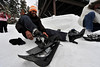 Walt Hester | Trail-Gazett<br /> Anu Godishala of Buffalo, N.Y. swears her high-healed shoes are waterproof as she straps snowshoes to them at Bear Lake on Wednesday.