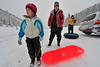 Walt Hester | Trail-Gazett<br /> OlyviaMeinking, 5, looks toward the slope at Hidden Valley while waiting for her mother, Ellen of Estes Park and grandfather, Ed, of Kansas City, Mo. on Tuesday. Even lower slopes in Rocky Mountain National Park received 10-12 inches of new snow since Monday.