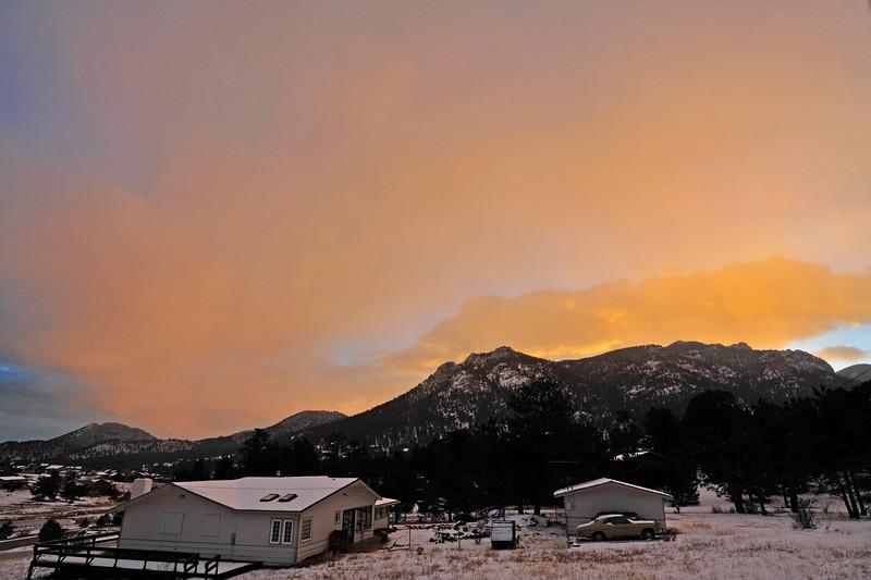Walt Hester | Trail-Gazette<br /> Dawn breaks over a snowy Estes Park on Thursday.
