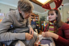 Walt Hester | Trail-Gazett<br /> Jo Ellen Murphey watches Erin Diedrich unwrap gifts at the Prospect Park Living Center on Wednesday. This is the fifth year that the customers from Prudential Team Realty have provided gifts to the residents at PPLC.