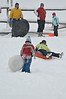 Walt Hester | Trail-Gazette<br /> Families slide down and que up on the snowplay slope at Hidden Valley on Tuesday. New snow has made for unusually good sledding for December.