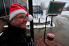 Walt Hester | Trail-Gazett<br /> Tom Gardner of thr Rotary Club of Estes Park Sports a snow-dusted Santa cap while bell ringing outside the post office on Tuesday. Snow finally fell in town this week after a very dry autumn.