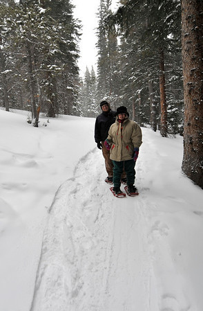 Walt Hester | Trail-Gazette<br /> A couple heads to Alberta Falls by way of Bear Lake. While ice climbing, telemark skiing and even snow camping are winter activities on offer in the park, snowshoeing seems to be the favorite.