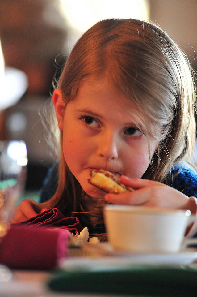 Walt Hester | Trail-Gazette<br /> Roby McLaughlin, 7, of Loveland enjoys a scone at the Elkhorn Lodge Christmas Tea on Sunday. Visitors were treated to cakes, scones, cookies and music at the event.