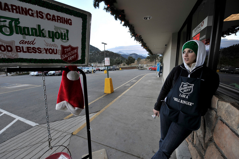 "Walt Hester | Trail-Gazette<br /> Jacqueline Cisneros, a Service Extension Reprisentative from the Denver Salvation Army, rings the bell at Safeway on Monday. ""Last year I was up and it was six degrees and windy, so this is great,"" said Cisneros."
