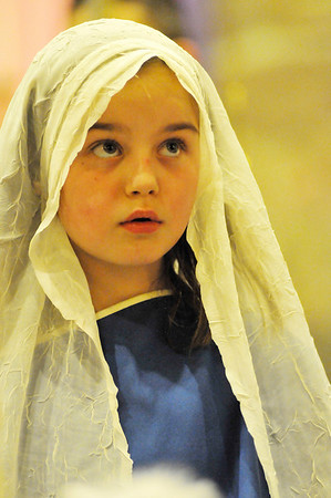 Walt Hester | Trail-Gazette<br /> Abby Housewright, 9, looks saintly in her role as Mary in the annual Christmas Pageant at Our Lady of the Mountains Cathlic Church on Sunday. The event puts the holiday season in full swing in Estes Park.