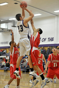 Walt Hester | Trail-Gazette Sam KellerTwigg shoots from above the crowd on Monday. KellerTwigg victimized the Saints with his turnaround-jumper for eight points in just the third quarter.