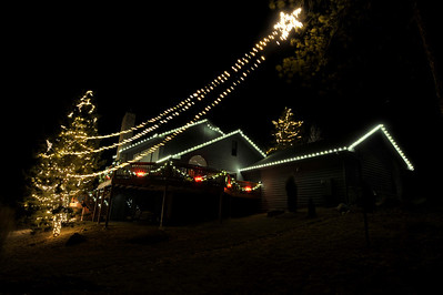 Walt Hester | Trail-Gazette High winds blows the tail of the star around in this display in Upland Heights on Monday.