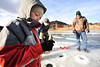 Walt Hester | Trail-Gazette<br /> Talon Adams, 6, examins his catch on one of the Scott Ponds on Sunday. Ice fishing is hard to come by in Estes Park, as most of the area lakes are resuervoirs and never completely freeze over.