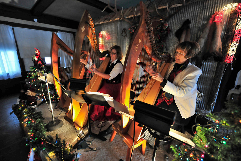 Walt Hester | Trail-Gazette<br /> Harps on the Rocks performs at the Elkhorn Lodge Holiday Tea on Sunday. The event brought attention to the historic lodge.