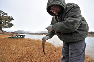 Walt Hester | Trail-Gazette Nikolay Serenkov hauls a trout out of Lake Estes on Wednesday. While temperatures were cold in Estes, it's all relative; Serenkov moved to Colorado from Russia one month ago.