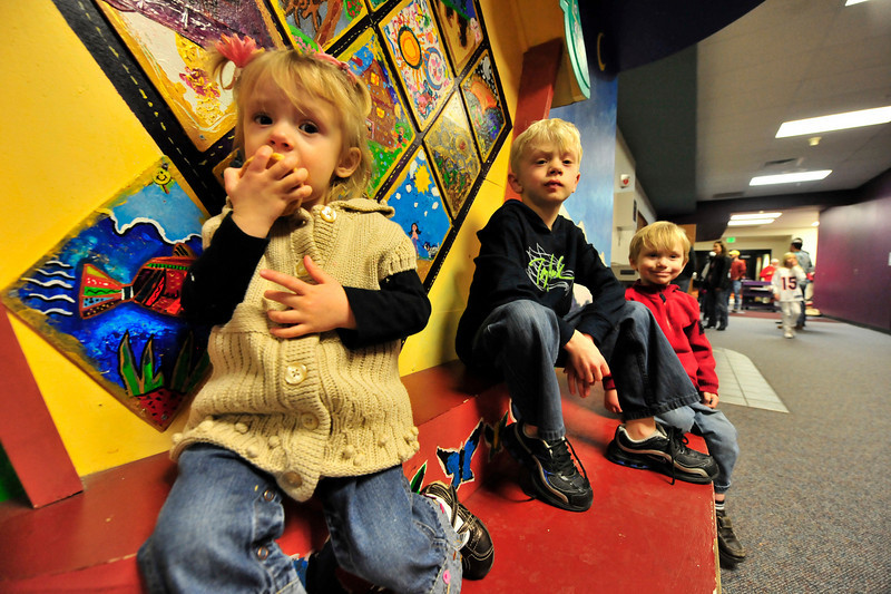 Walt Hester | Trail-Gazette<br /> Brook, 2, Carter, 8, and Conner Florance, 4, enjoy goodies and videos at the Parent/Teacher Organization's Lazagna Night at th Estes Park Elementary School on Friday.