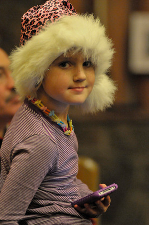 Walt Hester | Trail-Gazette<br /> Lexi Richardson, 5, awaits the arrival of Saint Nicholas at Our Lady of the Mountains Catholic Church on Sunday. The famous saint made an appearence after the annual Christmas Pageant.
