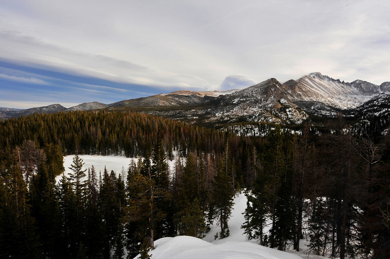 Walt Hester | Trail-Gazette<br /> Clouds strech out above Longs Peak and Nymph Lake last week. The Bear Lake/Dream Lake Trails are among the most popular winter trails in the park.