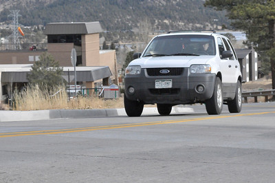 Walt Hester | Trail-Gazette A driver negotiates the bumpy pavement of Mocassin Drive on Tuesday. Town officials have stated thy plan to redue the recently completed paving of the street.