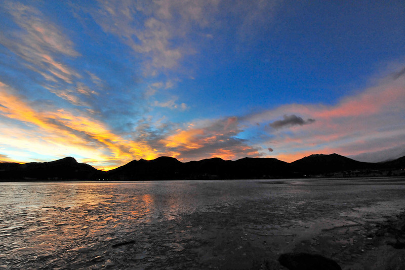 Walt Hester | Trail-Gazette<br /> Clouds and ice turn shades of orange above Estes Park on Friday. The early-week warmth will give way to colder temperatures as the week progresses.