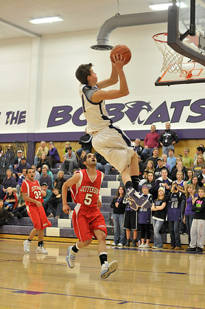 Walt Hester | Trail-Gazette<br /> Avi Weissman elevates to score on a fast break in the third quarter of Monday nights game. Coach Chad Nachtrieb was pleased with the Bobcats' break against the visiting Saints.