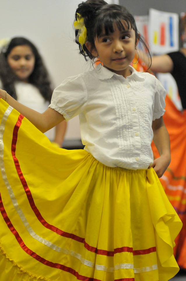 Walt Hester | Trail-Gazette<br /> Rebecca Lion, 6, twirles for first-graders during the class' Fiesta on Thursday.