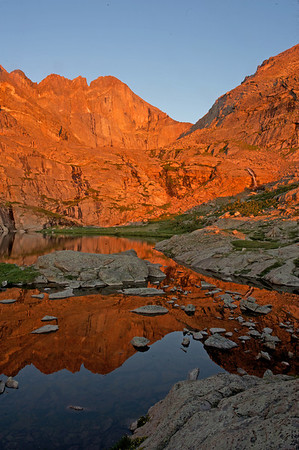 Walt Hester | Trail-Gazette<br /> A summer sunrise hits the Diamond on Longs Peak, and reflects off of the Peacock Pool. The view is an icon of Rocky Mountain National Park