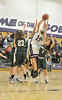 Walt Hester | Trail-Gazette<br /> Torrey Slininger leaps amid a stampede of Lady Buffs during the second quarter of Thursday's game. Slininger contributed eight points to the Ladycats' victory.