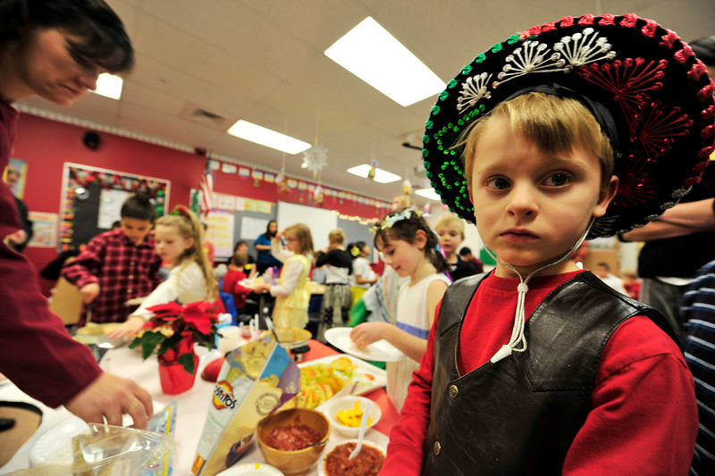 Walt Hester | Trail-Gazette<br /> Ben Ferree sports a festiv sombrero at the first-grade fiesta on Thursday. Students enjoyed food and dancing at the little celebration.