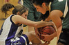 Walt Hester | Trail-Gazette<br /> Marley Mardock wrestles Machebeuf's Dianna Montoya for a loose ball during Thursday's tilt. The Ladycats defeated the visiting Lady Buffs in a close, hard faught game.