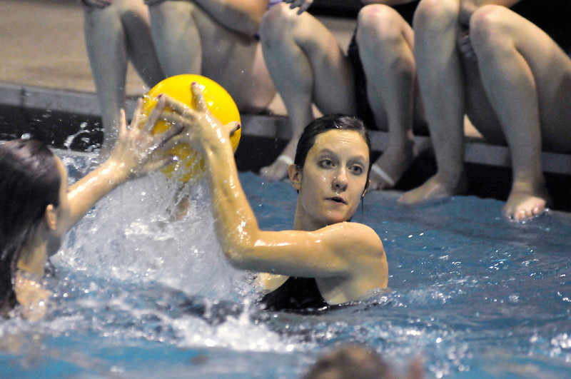 Walt Hester | Trail-Gazette<br /> Ladycats' cager Chelsea Weitzel prepares to fire on the swimmers' goal during a game of water polo on Friday. The basketball players beat the swimmers in their annual friendly competition.