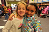 Walt Hester | Trail-Gazette<br /> Josephine Ryan and Gabriella Stough, both 6, enjoy each other's company and their pajamas on Friday. The Elementary School enjoyed Polar Express Day on the last school day before thr winter break.