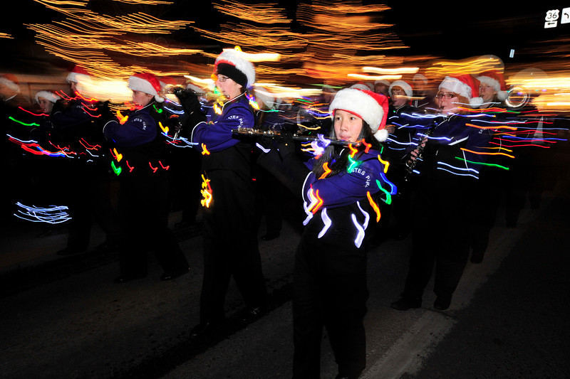 Walt Hester | Trail-Gazette<br /> The award-winning Bobcats' Marching Band lights up Elkhorn Avenue with their music as well as their uniforms on November 26. The band sports mobile Christmas lights powered by battery packs.