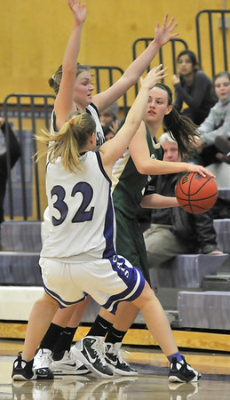 Walt Hester | Trail-Gazette<br /> Ladycats Julia Lawrence and Kyra Stark trap a Machebeuf player as time gets short in Thursday's game. The contest was close throughout, and was not decided until the very end when Julia Lawrence intercepted a Machbeuf pass as time expired.