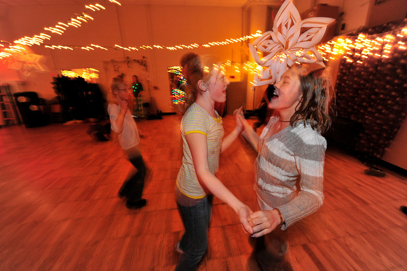 Walt Hester | Trail-Gazette<br /> Katheryn Carnell and Lily Tomasula enjoy music and dancing during the Estes Park Middle School's Winter Festival on Friday. The festival is a chance for the students to have a little fun to gether before the winter break.