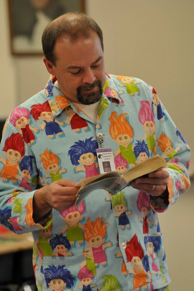 Walt Hester | Trail-Gazette<br /> Third-grade teacher Terry Leija reads to his class in his PJs on Friday. Teachers also enjoyed Polar Express day with the students.