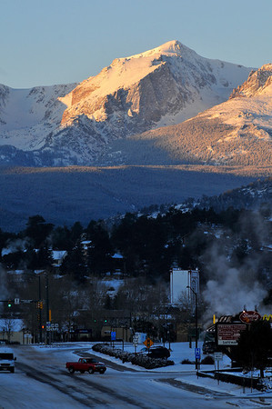 Walt Hester | Trail Gazette<br /> A bitter-cold dawn breaks over the Continental Divide and Estes Park on Wednesday. Temperatures varied from -22 downtown to -32 at MacGregor Ranch and parts of Carriage Hills.