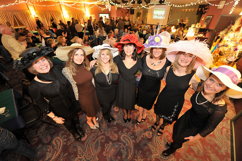 Walt Hester | Trail Gazette<br /> Ladies at the Rotary Club's Casino Night show off hats for their hat contest on Saturday night.