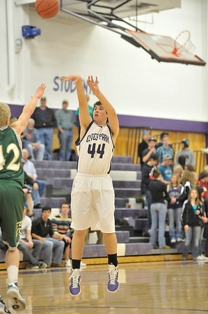 Walt Hester | Trail Gazette<br /> Senior John Oja knocks down two of his 14 points against Highland on Friday. The total was a single game high for Oja.