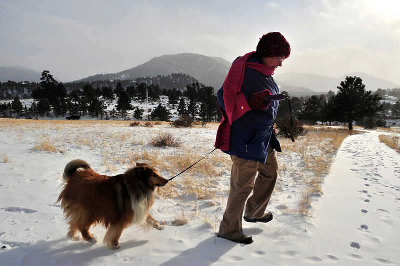 Walt Hester | Trail Gazette<br /> Laura Hopeck, a part-time Dallas resident, walks her dog, Maverick, through the snow and bittercold on Tuesday afternoon. Temperaturs and windchills were expected to be dangerously cold Tuesday night into Wednesday.